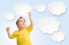 Kid or child keep cloud and sun in his hands Royalty Free Stock Photo
