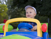 Kid in children in car Royalty Free Stock Photos