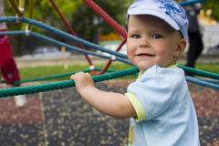 Kid on  children's playground Royalty Free Stock Photos