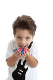Kid with chocolate eggs on his hands Royalty Free Stock Image