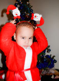 Kid in Christmas costumes. Little helper of Santa Claus stock photo