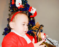 Kid in Christmas costumes. Little helper of Santa Claus royalty free stock image