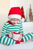 Kid at christmas Stock Images