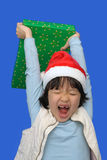 Kid with Christmas gift Stock Photo