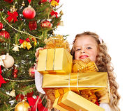 Kid with Christmas gift box. Royalty Free Stock Photo
