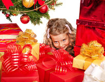 Kid with Christmas gift box. Royalty Free Stock Image