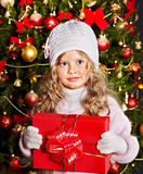 Kid with Christmas gift box. Stock Photos