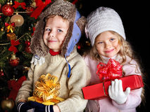 Kid with Christmas gift box. Stock Images