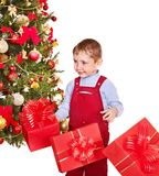 Kid with Christmas gift box. Royalty Free Stock Photography