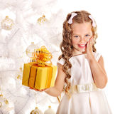 Kid with Christmas gift box. Stock Photo