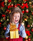 Kid with Christmas gift box. Stock Image