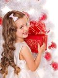 Kid with Christmas gift box. Royalty Free Stock Image