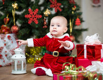 Kid with Christmas gift boxes Stock Images