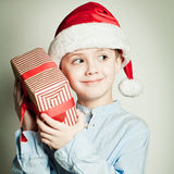 Kid with Christmas gift Royalty Free Stock Photography