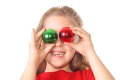Kid christmas ornament eyes. Shot of a kid christmas ornament eyes Royalty Free Stock Photos