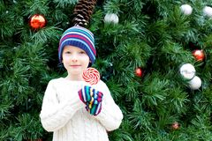 Kid at christmas time Royalty Free Stock Image