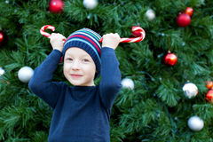 Kid at christmas time Royalty Free Stock Photos