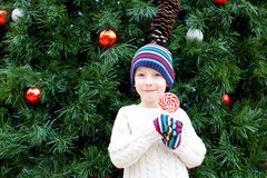 Kid at christmas time Stock Photos