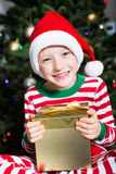 Kid at christmas time Royalty Free Stock Images