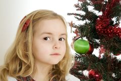 Kid and christmas tree Royalty Free Stock Image