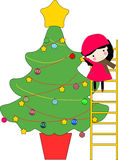 Kid and christmas tree Stock Photos