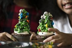 Kid Christmas tree decorated cupcakes stock images