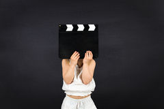 Kid with clapper board Stock Photo