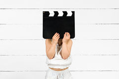 Kid with clapper board Royalty Free Stock Images