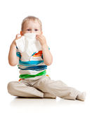 Kid cleaning nose with tissue Stock Photos