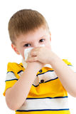 Kid cleaning nose with tissue isolated. On white Stock Image