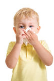 Kid cleaning nose with tissue isolated. On white Royalty Free Stock Image