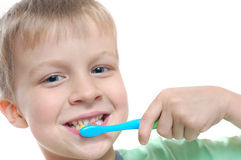 Kid cleaning teeth stock image