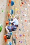 Kid climbing Stock Photography