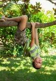 Kid climbing on a tree Stock Image