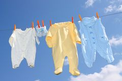 Kid clothes. The kid clothes against blue the sky Royalty Free Stock Photo