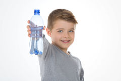 Kid with a cointaner of water Royalty Free Stock Photos
