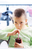 Kid with cold drink royalty free stock photos