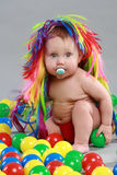 Kid with the colored balls. Stock Photo