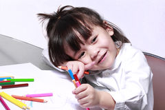 Kid with colored pencils. Kid play with colored pencils stock image