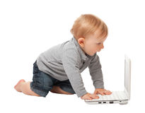 Kid and computer Stock Photos