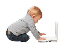 Kid and computer Royalty Free Stock Image