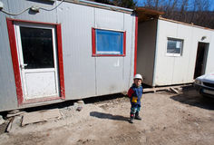 Kid on construction site Stock Image