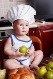 Kid cook. Little cook: fruits and baby food Royalty Free Stock Photos
