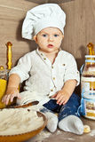 The kid cook cooks food Stock Image