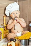 The kid cook cooks food Stock Images