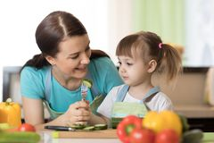 Kid cooking with their mother Royalty Free Stock Photos