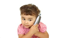 Kid on cordless phone Royalty Free Stock Image