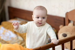 Kid in cot Stock Photography