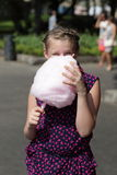 Kid with cotton candy Royalty Free Stock Photography