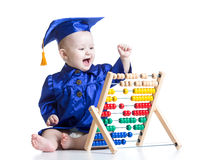 Kid with counter toy. Concept of early learning Royalty Free Stock Photography